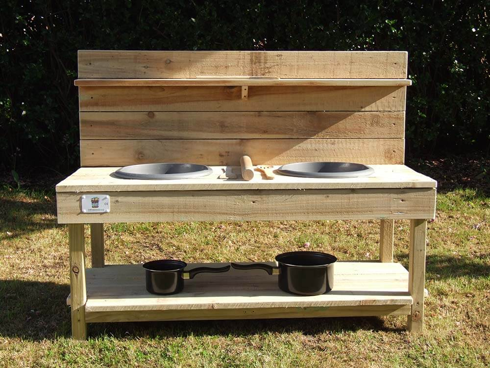 Mud Kitchen With Pans on Bottom Shelf