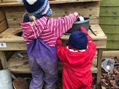 Maisie & Rowan Using Their Mud Kitchen